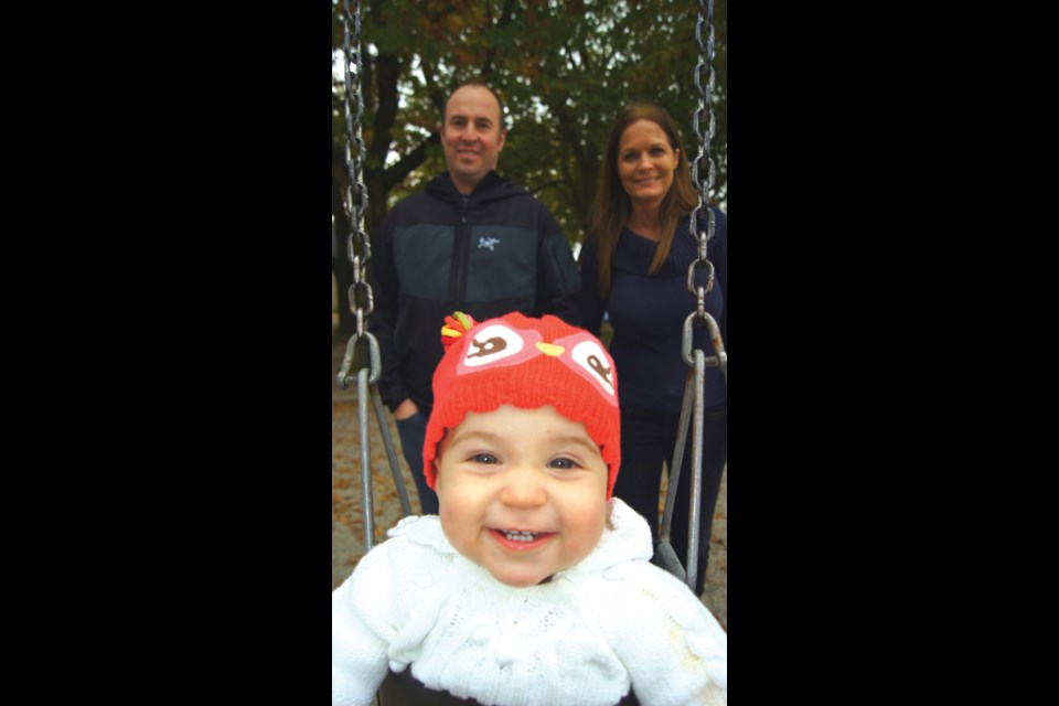 Graeme Wood/Special to the News Dave and Colette Young, with baby Brooke, enjoy a day at the playpark. Dave enjoys living close to the Canada Line, the city centre and to the park.