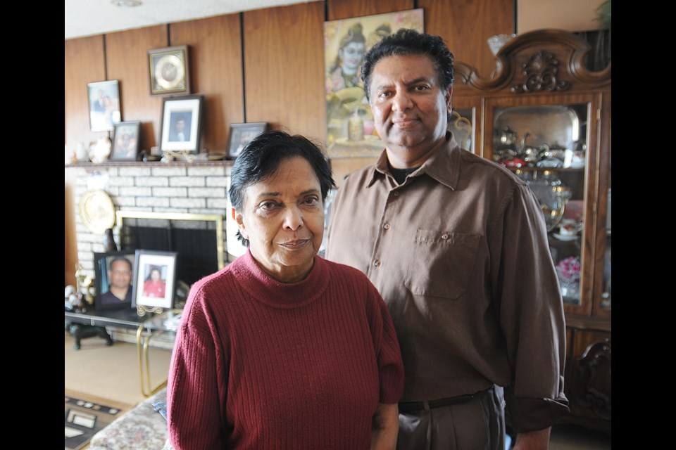 Kamla Prasad (l) and her son-in-law, Ahmed Buksh stand in the living room of the house Prasad has lived in since 1973 at 1017 Marine Drive. photo Dan Toulgoet