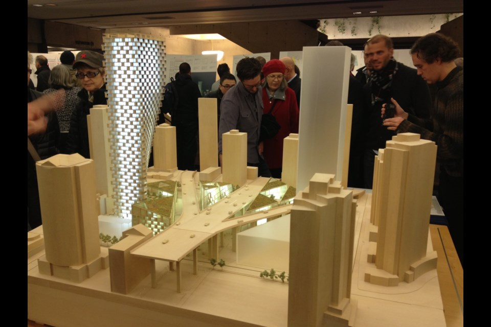 This model of the Westbank development project at the north end of Granville Street Bridge was revealed at an open house last February. It was the second of two open houses and attracted 403 visitors and a total of 51 comment sheets — 71 per cent in support, 14 per cent opposed. Photo by Naoibh O'Connor