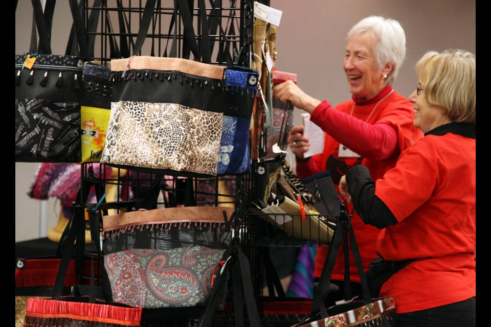 Shopping for a cause: Royal City Gogos Penny Perry and Carolyn Neighbor look at purses at the Artisan Crafts for Africa at last year's Artisan Crafts for Africa Sale. This year's sale is one of our Top 5 picks for the weekend in New West.