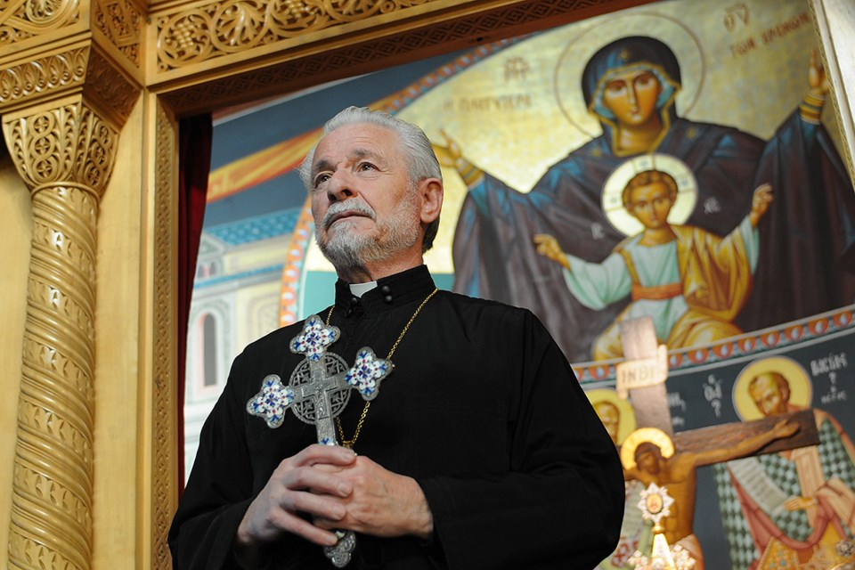 Rev. Demetrios S. Partsafas, who presides over the beautiful St. George Greek Orthodox Cathedral. Photo Dan Toulgoet