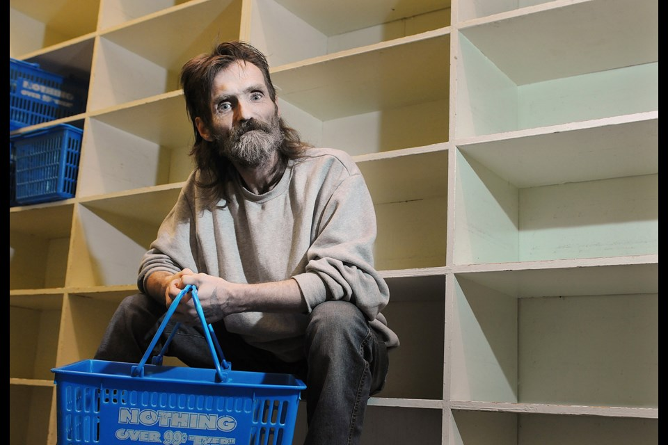 """Joe (JP) Smith is both a volunteer and client of AIDS Vancouver's """"grocery store,"""" which seeks donations heading into the holidays. Photo Dan Toulgoet"""