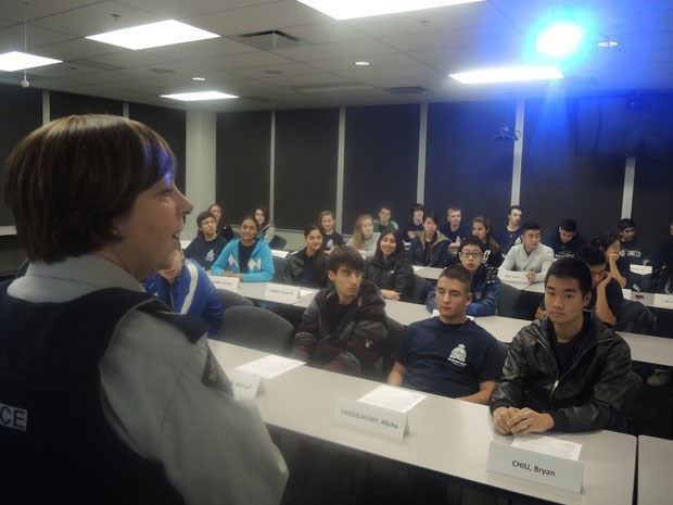 Cpl. Anette Martin talks to the youth squad before they receive their final presentation.