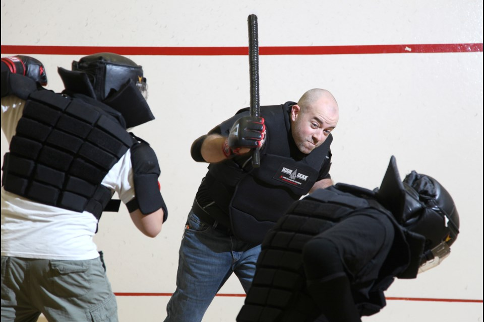 Friendly faceoff: Dan Rheaume, centre, takes on other members of the Heisei Budo self-defence group at a recent drop-in at SFU.