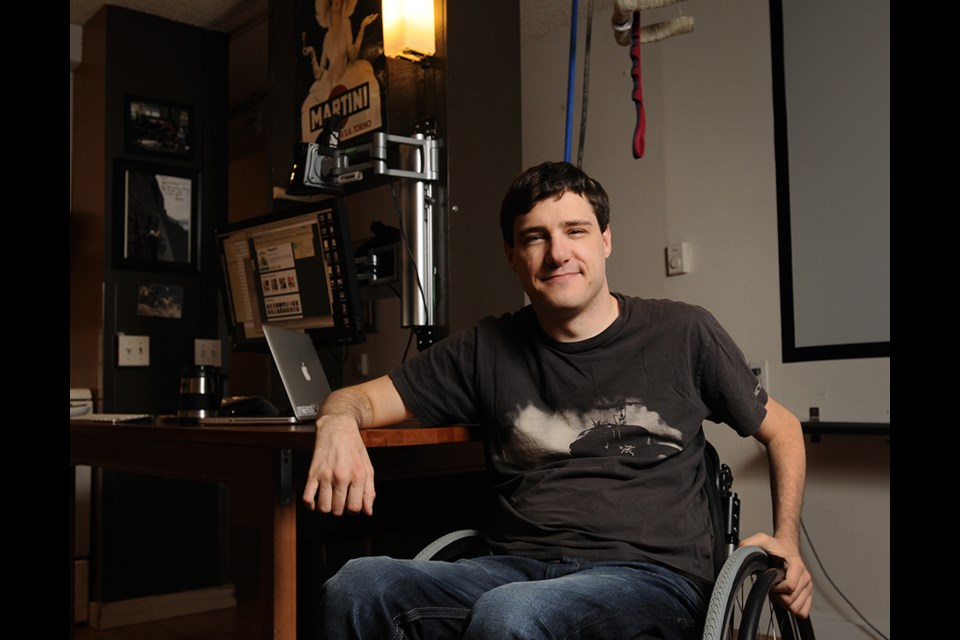 "Rockclimber Brad Zdanivsky, photographed in his living room with his pulley weight system for working out, is familiar with ""boosting,"" which many Paralympians partake in to enhance performance. Photo Rebecca Blissett"