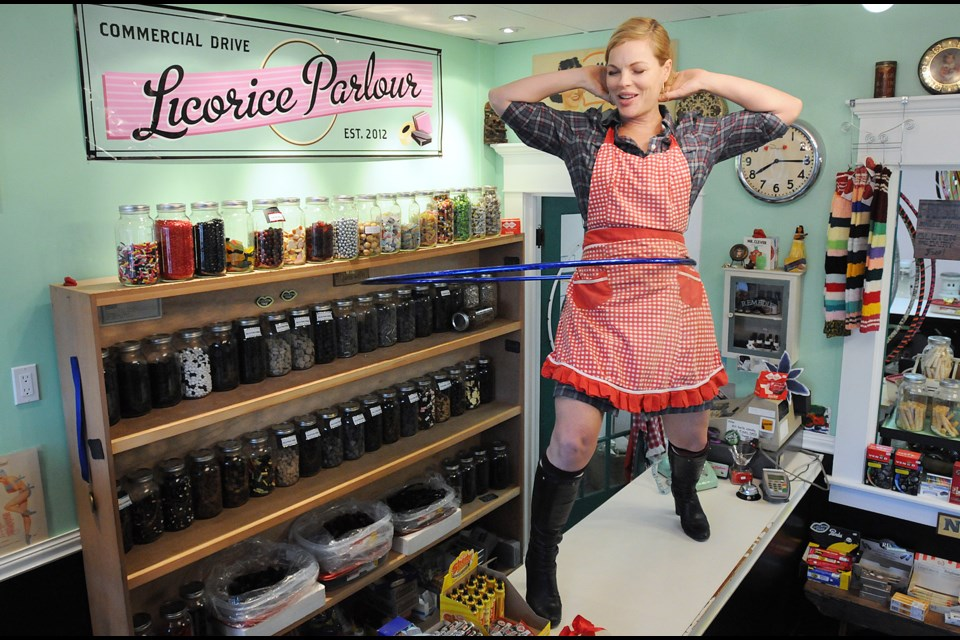 Commercial Drive Licorice Parlour owner Watermelon shows off her hula hoop skills.