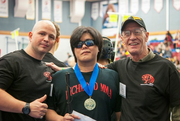 Johnny Tai shows off his gold medal.