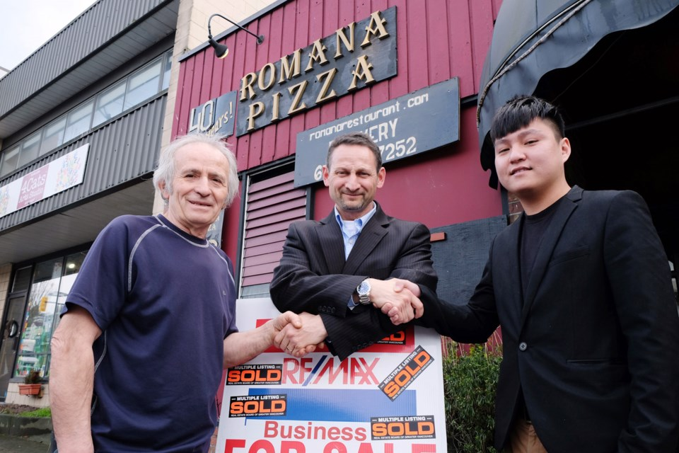 From left to right, Eugene Siormanolakis, former owner of Romana Pizza, realtor Frank Pupo and new owner Calvin Han stand outside the 41-year-old restaurant.