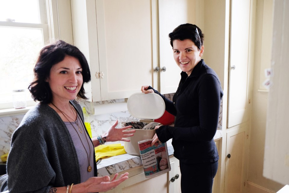 """Green coach Jen Casey, left, and homeowner Katie Schiebler are working to make the family's life a """"darker shade of green."""""""