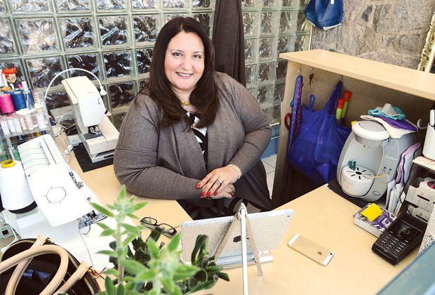 Sherry Matin shows off the 50-square-foot alterations shop she recently opened on Lonsdale Avenue at 19th Street.