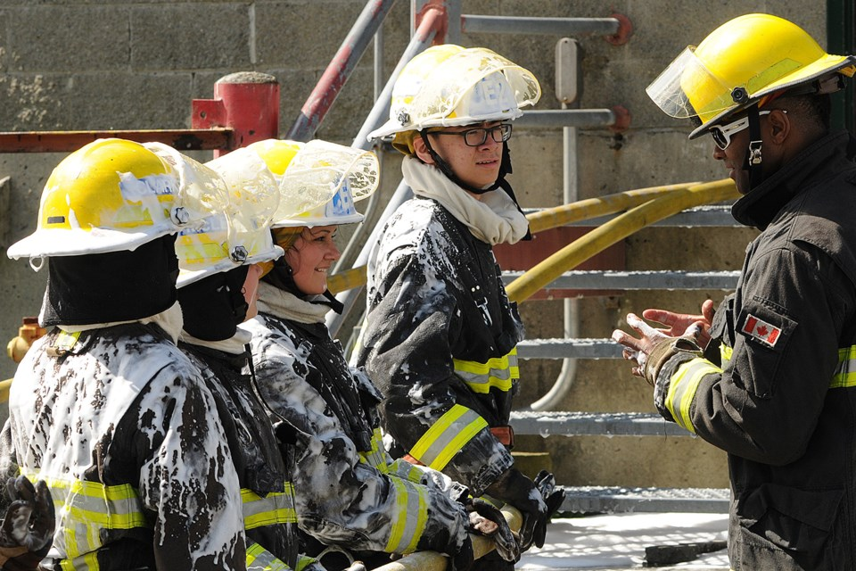 """Twenty-four high school students wrapped up an intense week of firefighting boot camp at Vancouver Fire and Rescue Services' training centre. Students attended a grueling five-day Youth Outreach Academy program where they acquired firefighting skills, first aid, search and rescue techniques and hands-on use of the """"jaws of life."""" Photos Dan Toulgoet"""
