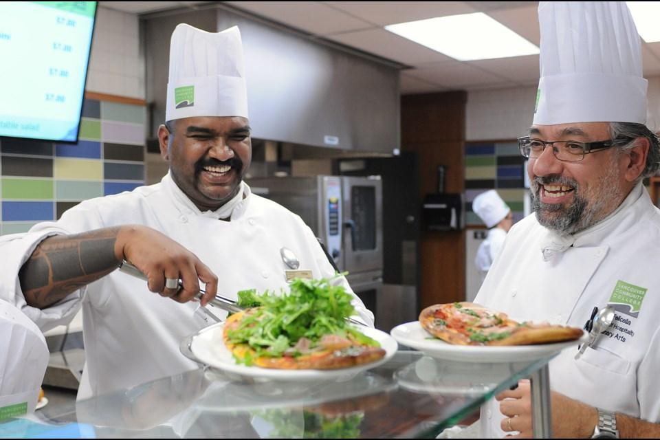 VCC's new cafeteria Quizine, Chef JC Felicella and student Titus Joseph (L) in the Culinary Arts program. Photo Dan Toulgoet