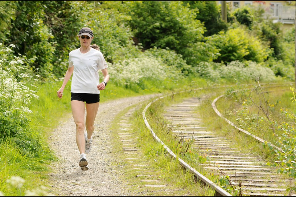 A jogger uses the Arbutus Corridor near the S curve. Photo: Dan Toulgoet