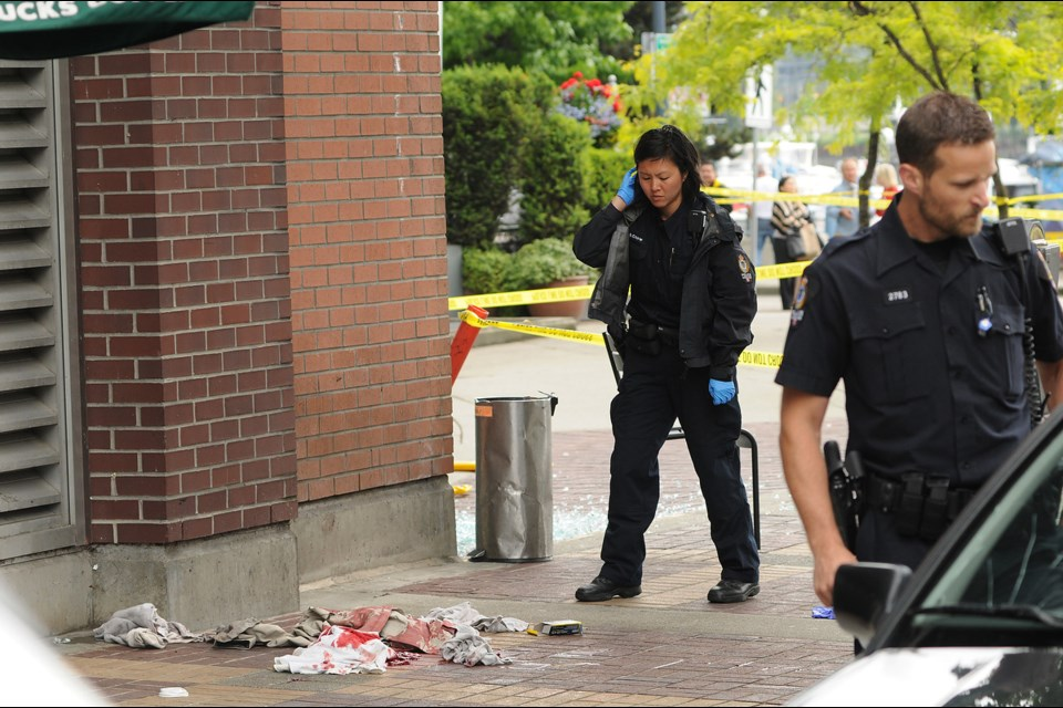 A man was seriously injured in a shooting at Davie Street and Marinaside Crescent outside of the Starbucks in Yaletown Tuesday morning. Photo: Dan Toulgoet