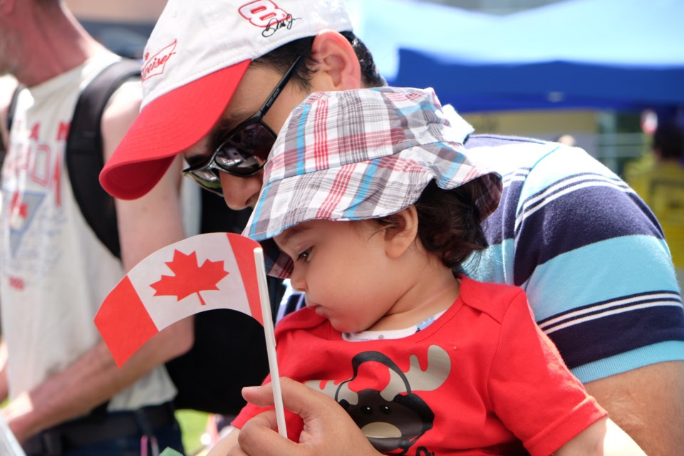 Ankur and 14-month-old Kartik at the Canada Day celebrations held at Edmonds Community Centre.