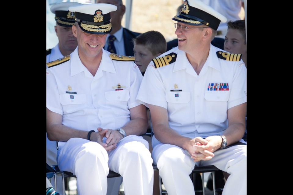 Outgoing base commander Commodore Luc Cassivi, left, and new base commander Capt. Steve Waddell listen to speeches during a Canadian Forces Base Esquimalt Change of Command ceremony at the CFB Esquimalt Naval and Military Museum Wednesday.