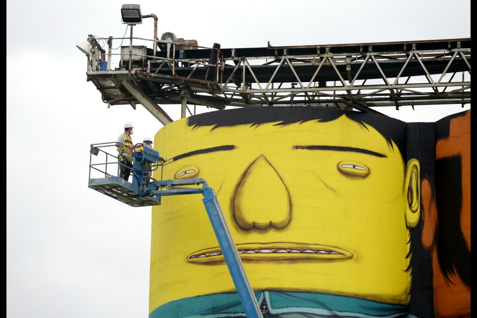 Brazilian twin artists Os Gemeos began detailed painting Aug.13 on six concrete silos towering over Granville Island. The official unveiling is on Sept. 7. photo Jennifer Gauthier