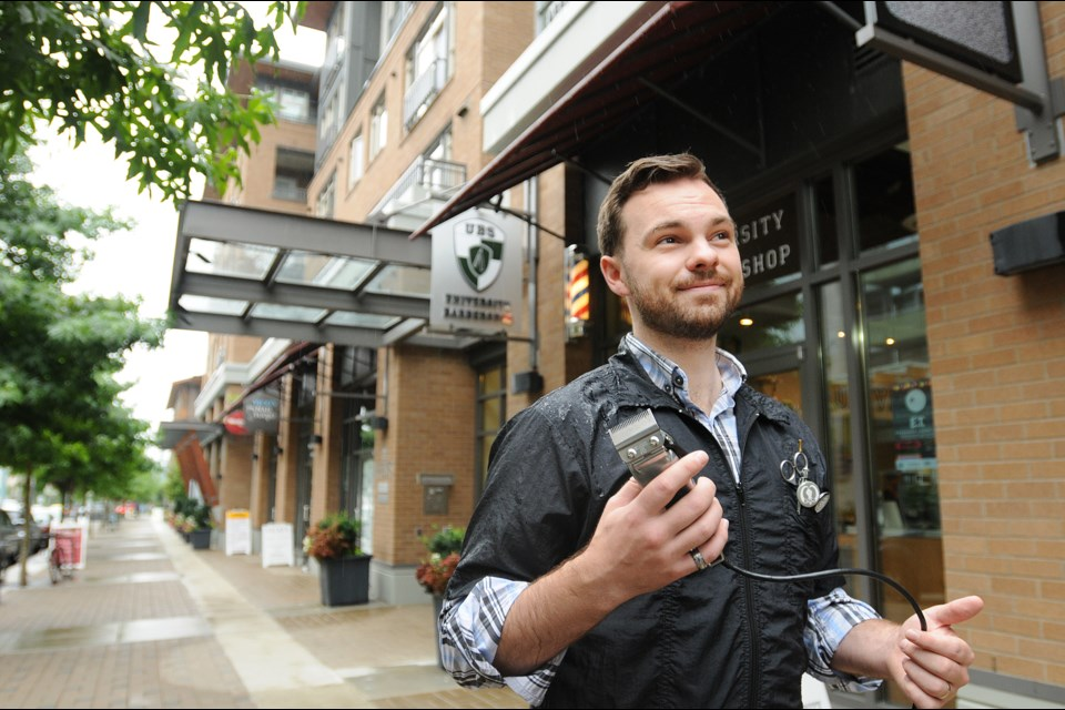 Brennan Cuff opened the University Barbershop in Wesbrook Village in February 2013. He used to live near the university and saw the community's potential for growth. Photo Dan Toulgoet