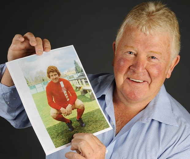 Chris Bennett holds up a photo from his playing days as a 17-year-old with North Shore United. Bennett began his soccer career in North Vancouver and his 50 years of playing and coaching success has landed him a spot in the Canadian Soccer Hall of Fame's class of 2014.