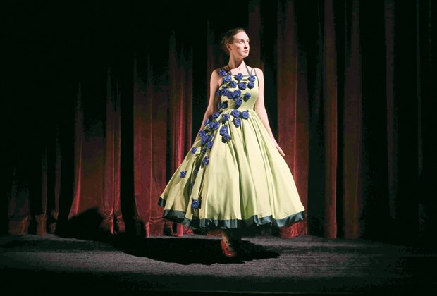 Bronwyn Malloy wears a green charmeuse gown with blue rosettes, inspired by astrocytes growing in a