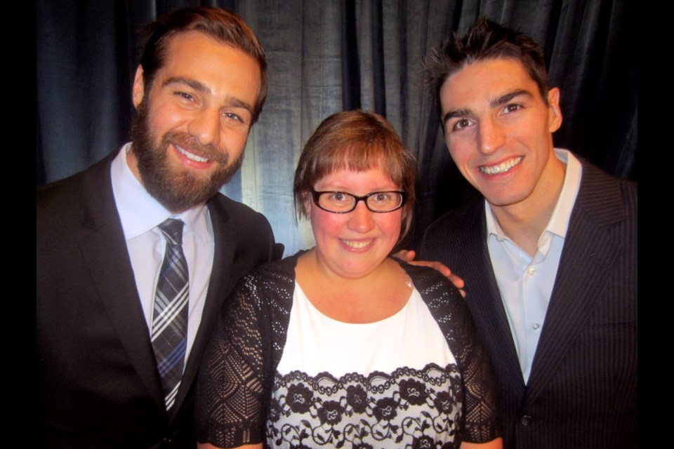 Vancouver Canucks Chris Higgins and Alex Burrows flanked Special Olympics B.C. athlete and Sports Celebrities Gala keynote Kristina Ettema at the interactive fundraiser held at the Hotel Vancouver.