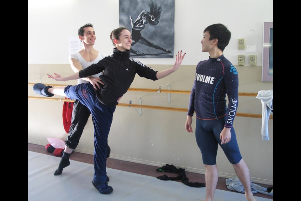 Rehearsal zone: Guest dancer Diego Ramalho leads Ana Paula Oioli in agraceful movefor their parts as Snow King and Snow Queen whiledancer Yuta Kawakami looks on.