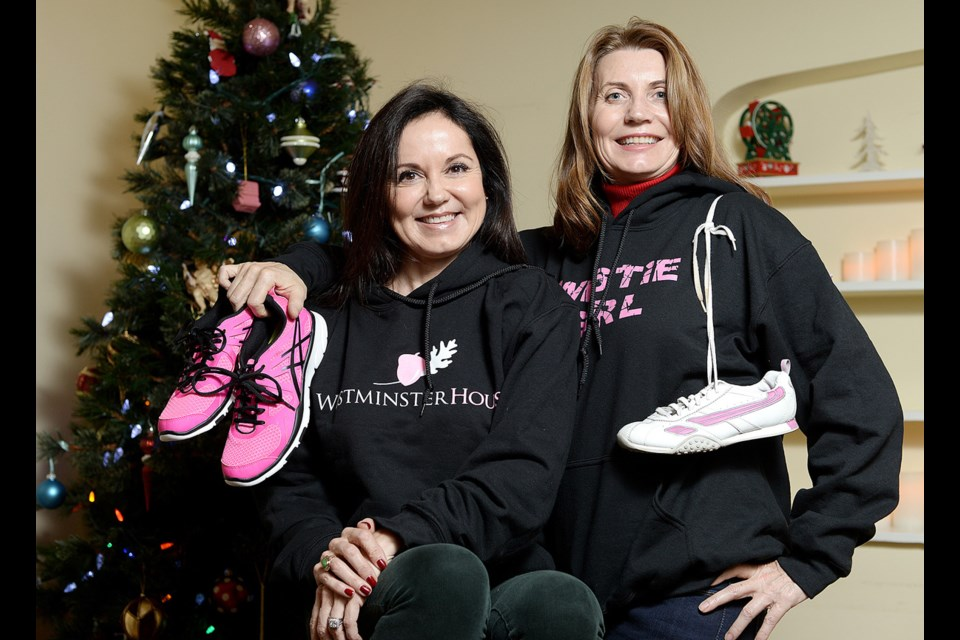 Susan Hogarth, left, and Sarah Franklen of Westminster House, held a Make Your Shoes Count holiday challenge in 2014. It was one of the local organizations featured in last year's Guide to Giving.