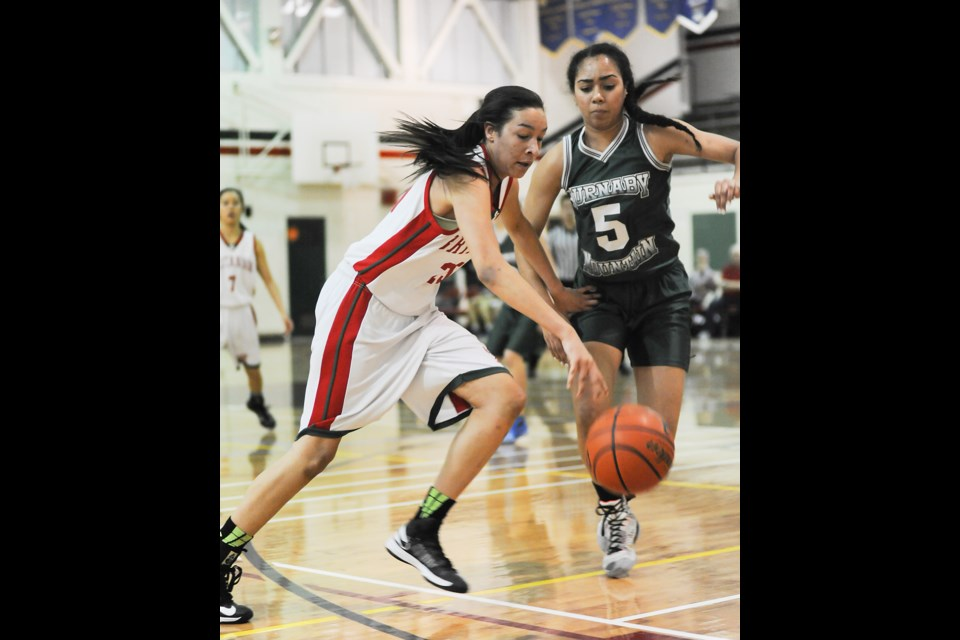Britannia Bruin Lauren Powell charges past Burnaby Mountain's Jacey Bailey during the final of the Britannia Invitational on Jan. 17, 2015. The Bruins won 76-58. Photo Rebecca Blissett