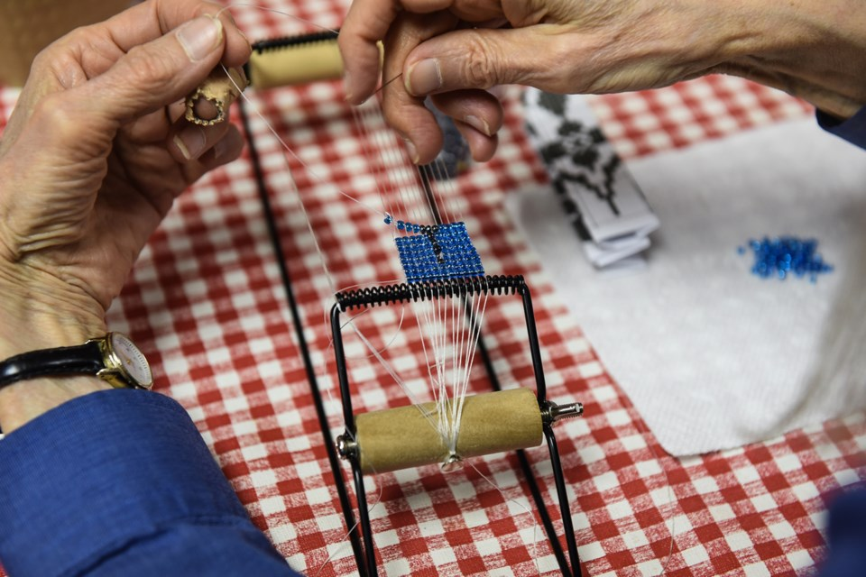 Savannah Walling worked on a loom during Saturday's Ukrainian bead jewelry-making workshop as part of the weekend's first Ukrainian Arts & Culture Fest at the Ukrainian Cultural Centre in Strathcona. Photograph by: Rebecca Blissett