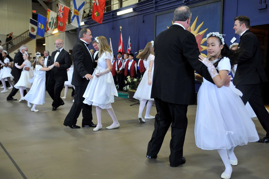 A tradition continues: Royal Lancers and members of the 2014 and 2015 May Queen suites danced their traditional quadrille dances at the inaugural community heritage picnic at the Royal Westminster Regiment Armoury on Sunday.