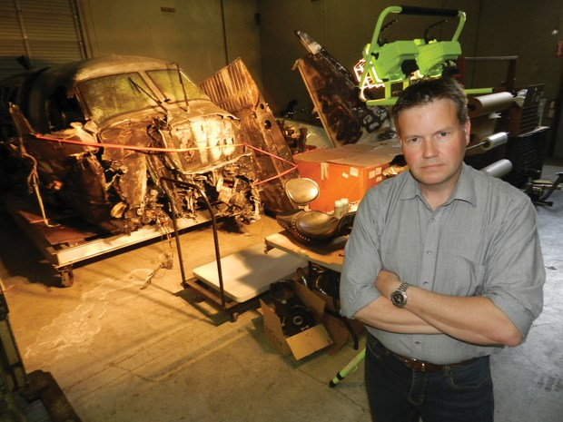 Alec Moffat, senior investigator and director of operations at Waldron, with wreckage of the Northern Thunderbird Air flight that crashed short of the runway at YVR in Oct. 2011.
