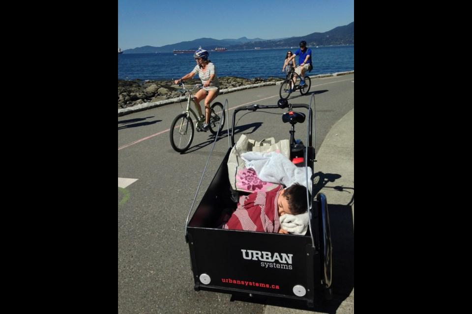Blair Smith's son, Shay, naps in Urban System's Christiana cargo bike.