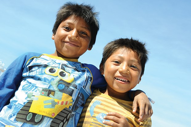 Two brothers are all smiles as they meet boats on the docks of Loreto, Baja California Sur.