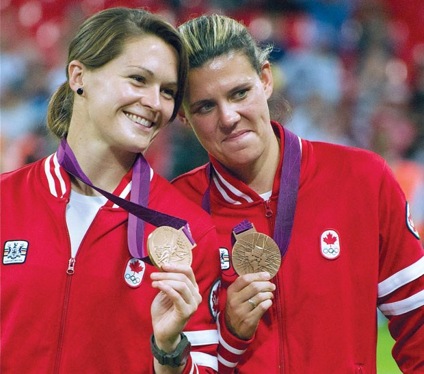 Erin McLeod and Christine Sinclair display their bronze medals following a win over France at the 2012 Olympic Summer Games.