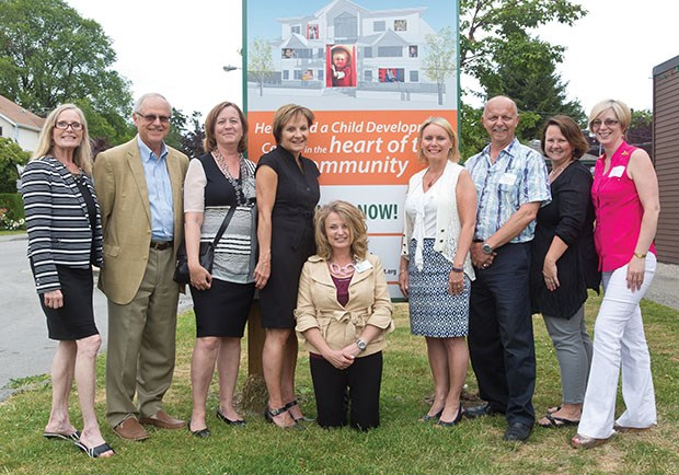 Officials of the Reach Child and Youth Development Society are all smiles at a ceremony Wednesday afternoon to mark the halfway point of their $5 million capital campaign.