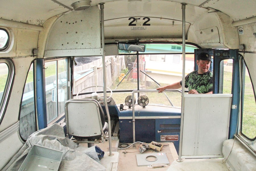 Victor Purdy shows off his 1969 Alaska tour bus.