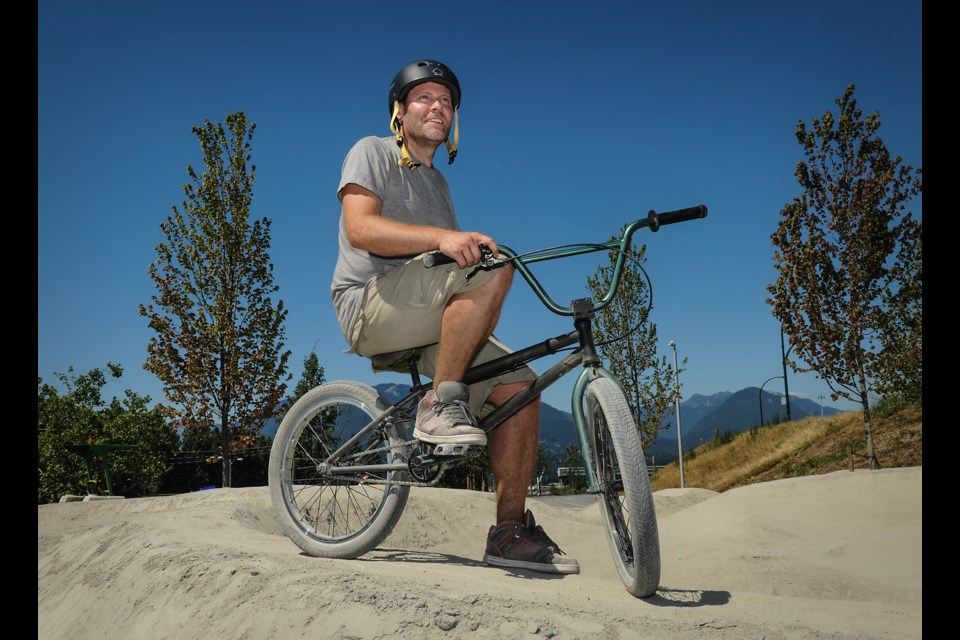 Chris Young of the Vancouver Dirt Jump Coalition hung out at the new BMX pump track during the opening day of Empire Fields and Plateau Sports Park on Saturday. Photograph by: Rebecca Blissett