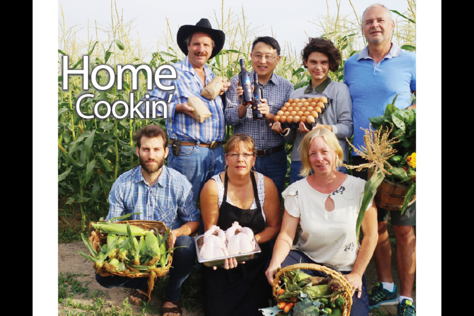 (back, from left to right) Bill Zylmans of W A Farms; Tom Yuan, director of Canada Berries Enterprises Ltd.; Holly Easterbrook and Steve Easterbrook, of Rabbit River Farms; (front, from left to right) Will Dunn, vice-president of the Richmond Food Security Society, Kelly May, owner of the Fowl Farmer; Anita Georgy, executive director of the Richmond Food Security Society. The RFSS hosted a local food eating challenge in August, 2015.
