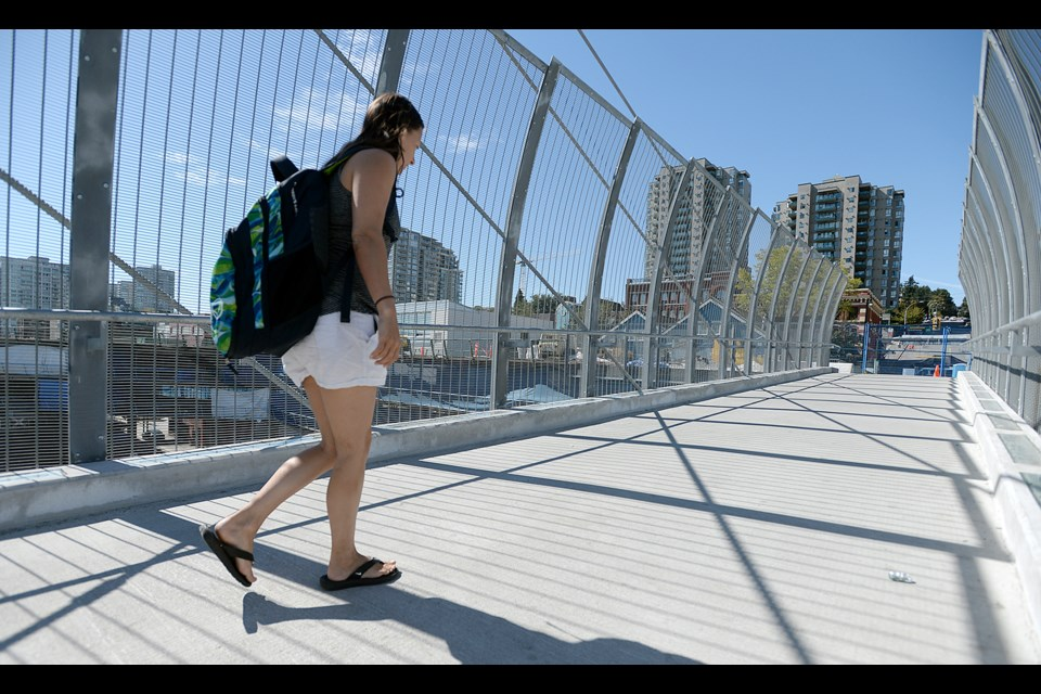 Pedestrians are able to access Westminster Pier Park via a new overpass, but the project's elevator has been delayed.