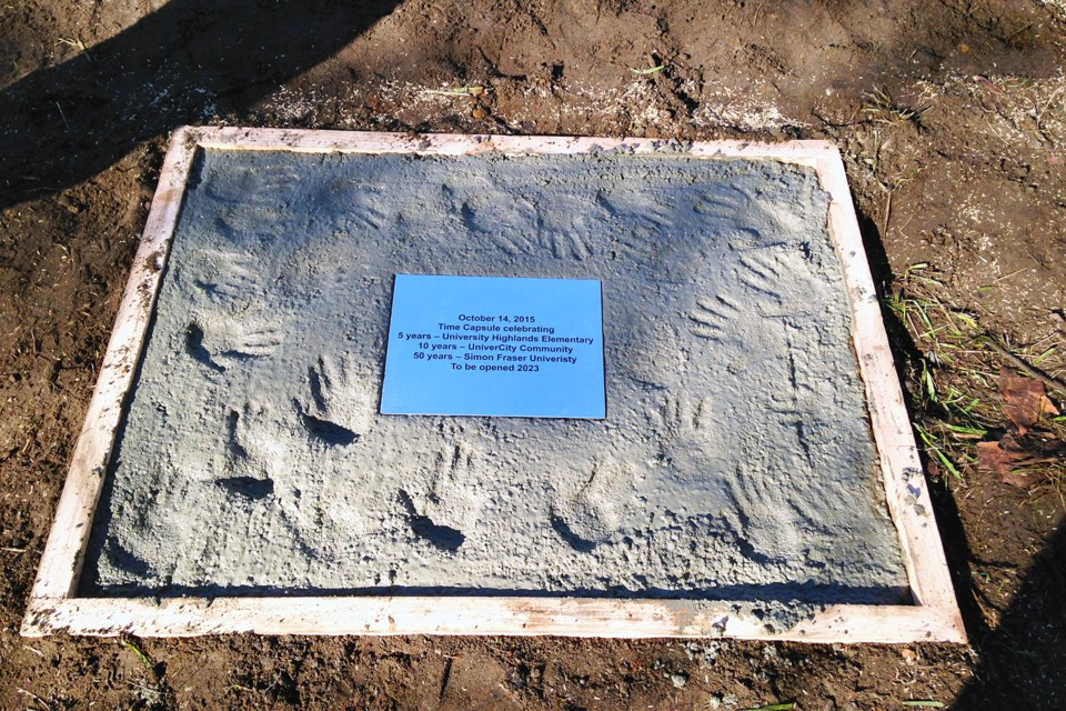 The concrete slab covering a time capsule buried at University Highland Elementary on Oct. 14 features a hand print from each of the school's current kindergarten kids.