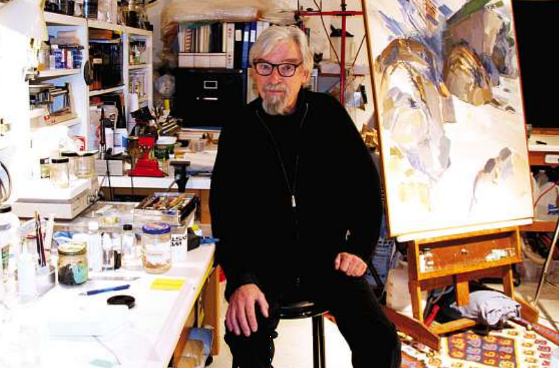 Art restorer Andrew Todd with a restoration project in his studio. photo: Louise Loik