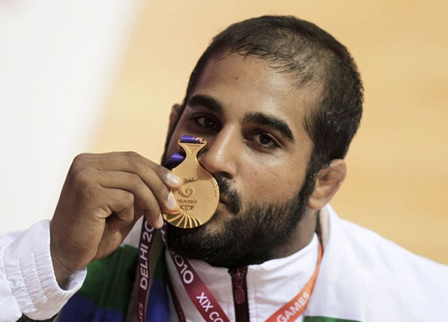 Olympic wrestler Arjan Bhullar with his 2010 Commonwealth gold medal.