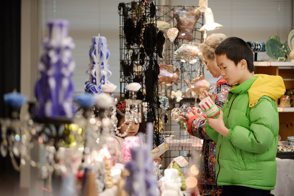 A young visitor checks out some of the offerings at the Deer Lake Craft Festival.