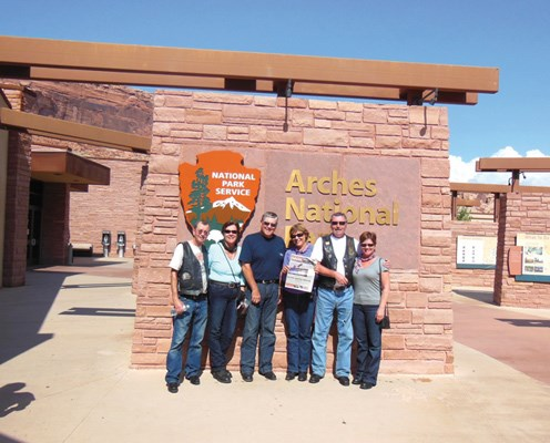 Peter and Sandra Anderson, Tony and Mary Ann Skeans, and Bernard and Cathy Favreau visit Arches National Park in Utah.