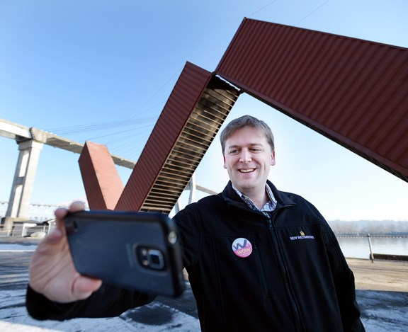 Mayor Jonathan Cote takes a selfie at the opening of WOW New Westminster