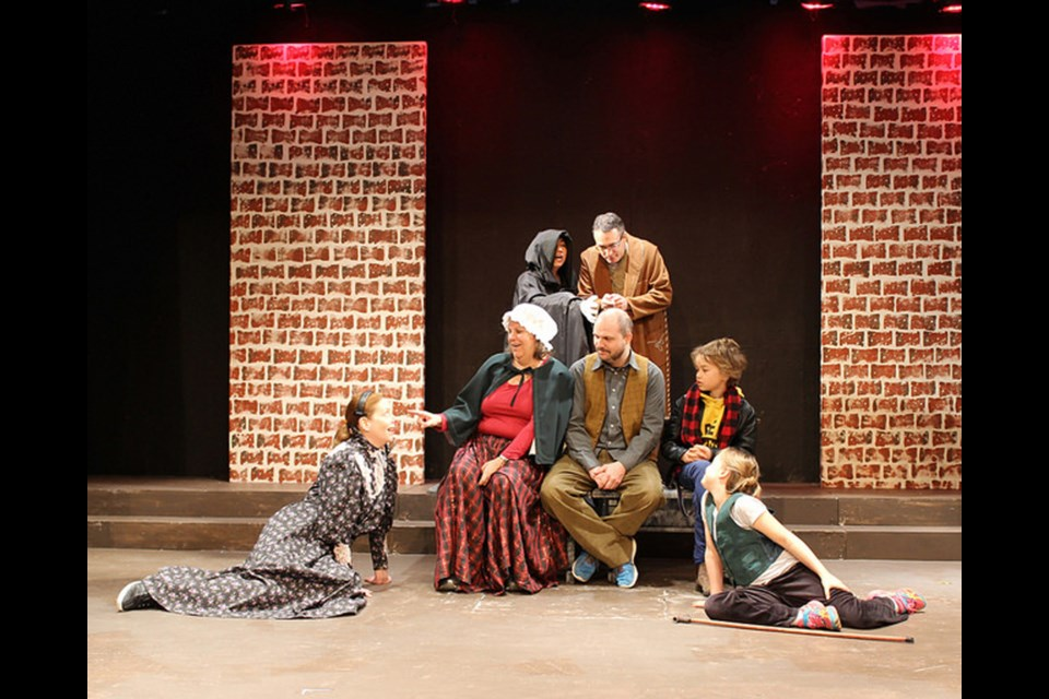 Inspecting Carol features (front, from left) Deborah Merrick, Diane Tzingounakis, Richard Wiens, James Hughes and Veronica Berg with (in back) Wynn Siu and Sheldon Landry. The Vagabond Players production is onstage until Dec. 19.