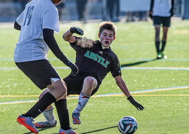 Miles Gailiunas of the Argyle Pipers senior boys soccer team slides in for a challenge during the AAA provincial championships held last week in Burnaby. The Pipers scored silver with a starting lineup that featured four Grade 10s and Gailiunas, who is in Grade 9.