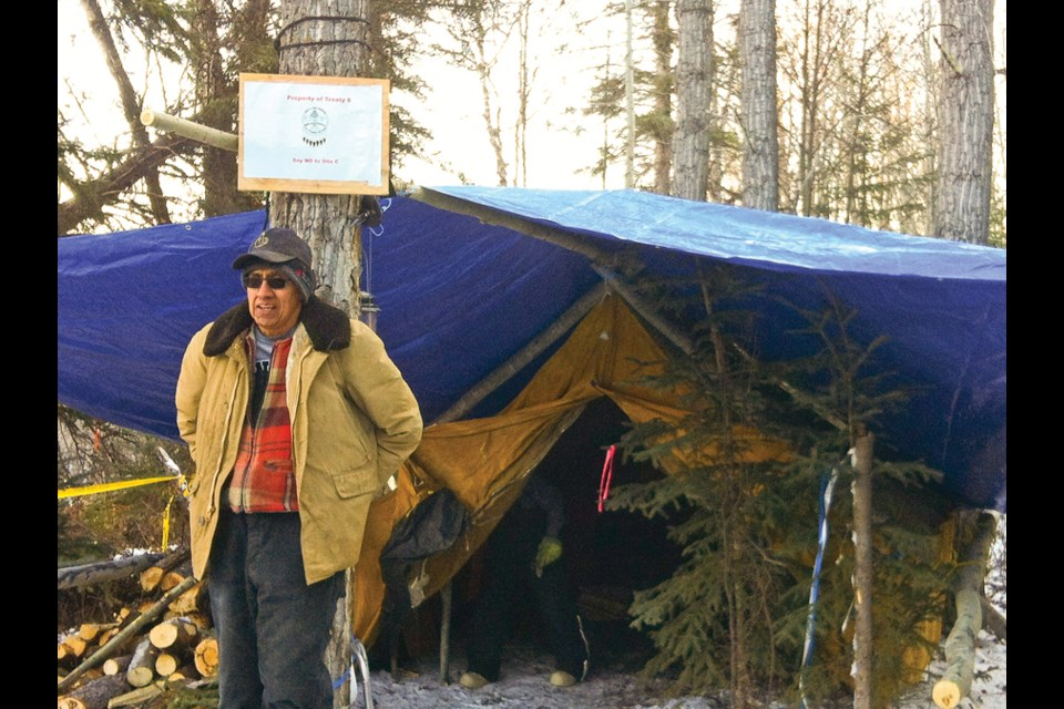 Former Treaty 8 Tribal Chief Bud Napoleon stands at the old Rocky Mountain Fort site near the Moberly River, where Site C opponents have set up a protest camp.