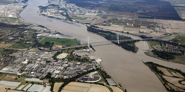 A rendering of the scale of the proposed $3.5 billion bridge across the south arm of the Fraser River, above the soon-to-be decommissioned Massey Tunnel. The bridge, at 3.5 kilometres long, will be the biggest of its kind in the province.