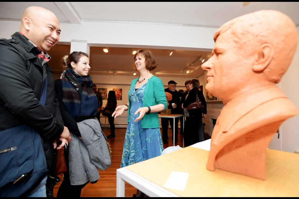 Artist Louise Solecki Weir with her piece Stephen Harper (Or In Considerations of the Controversial History of Political Statuary) (terracotta) at the opening reception for Moved by Portraits.